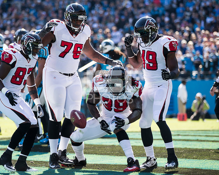 The Carolina Panthers defeated the Atlanta Falcons 34-10 in an inter-division rivalry played in Charlotte, NC at Bank of America Stadium.  Atlanta Falcons running back Steven Jackson (39) celebrates with his teammates after a touchdown run.
