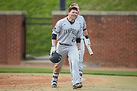 Spencer Packard (25) of the Campbell Camels is all smiles as he walks back to the dugout after hitting a 2-run home run against the High Point Panthers at Williard Stadium on March 16, 2019 in  Winston-Salem, North Carolina. The Camels defeated the Panthers 13-8. (Brian Westerholt/Four Seam Images)