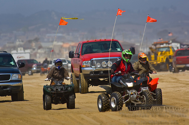 ATV's and passenger vehicles driving on the sand at Oceano Dunes State Vehicular Recreation Area, Oceano, California