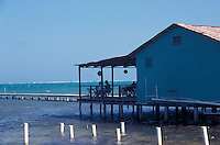 Tourists relaxing in a seaside bar and restaurant on Caye Caulker, Belize