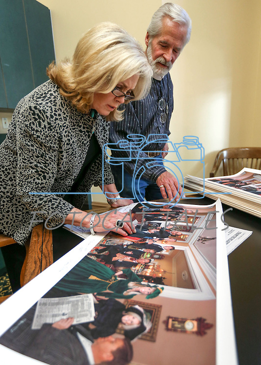 """Former first lady Dema Guinn and artist Steven Saylor talk about the """"Nine Cheers for the Silver State"""" artwork Saylor created, at the Capitol, in Carson City, Nev., on Wednesday, Sept. 24, 2014. Dignitaries featured in the painting will sign the 150 limited edition prints which will be sold as a fundraiser for the Comstock Foundation for History and Culture.<br /> Photo by Cathleen Allison"""