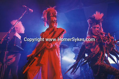 Tony James front man and lead singer of Sigue Sigue Sputnik. Punk band 1980s. Jane Farrimond,  on keyboards and Martin Degville. Newcastle Upon Tyne. UK
