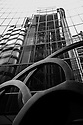 London, UK. 04.04.2015. Reflections of the Lloyds Building in the Willis Building, Lime Street, London, UK.Photograph © Jane Hobson.