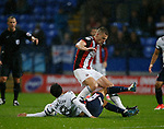 Jem Karacan of Bolton Wanderers tackles Paul Coutts of Sheffield Utd during the Championship match at the Macron Stadium, Bolton. Picture date 12th September 2017. Picture credit should read: Simon Bellis/Sportimage