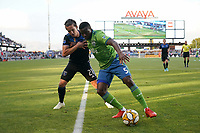 SAN JOSE, CA - SEPTEMBER 29: Nouhou #5 of the Seattle Sounders FC shields the ball from Carlos Fierro #21 of the San Jose Earthquakes during a Major League Soccer (MLS) match between the San Jose Earthquakes and the Seattle Sounders on September 29, 2019 at Avaya Stadium in San Jose, California.