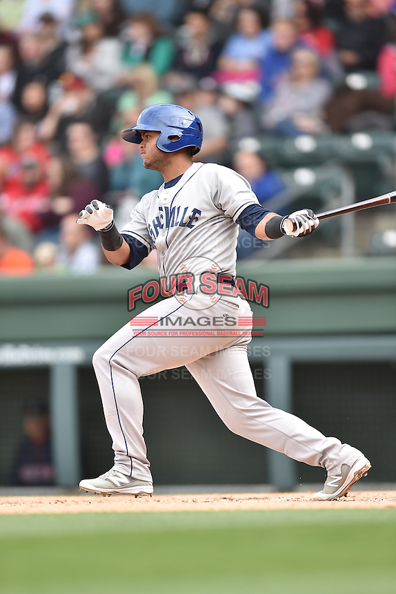 Asheville Tourists catcher Hamlet Marte (14) swings at a pitch during a game against the  Greenville Drive at Fluor Field on April 10, 2016 in Greenville South Carolina. The Drive defeated the Tourists 7-4. (Tony Farlow/Four Seam Images)