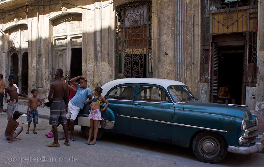 people talking next to a blue oldtimer, street scene in Havana Centro, Cuba