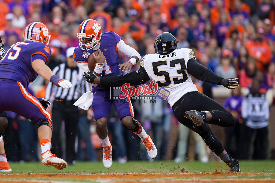 Deshaun Watson (4) of the Clemson Tigers is tackled by Duke Ejiofor (53) of the Wake Forest Demon Deacons during first half action at Memorial Stadium on November 21, 2015 in Clemson, South Carolina.  The Tigers defeated the Demon Deacons 33-13.   (Brian Westerholt/Sports On Film)