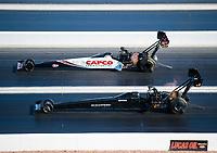 Nov 3, 2019; Las Vegas, NV, USA; NHRA top fuel driver Steve Torrence (far) races alongside Mike Salinas during the Dodge Nationals at The Strip at Las Vegas Motor Speedway. Mandatory Credit: Mark J. Rebilas-USA TODAY Sports