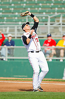 Lansing Lugnuts first baseman Balbino Fuenmayor (28) fields a pop fly against the Beloit Snappers at Cooley Law School Stadium on May 5, 2013 in Lansing, Michigan.  The Lugnuts defeated the Snappers 5-4.  (Brian Westerholt/Four Seam Images)