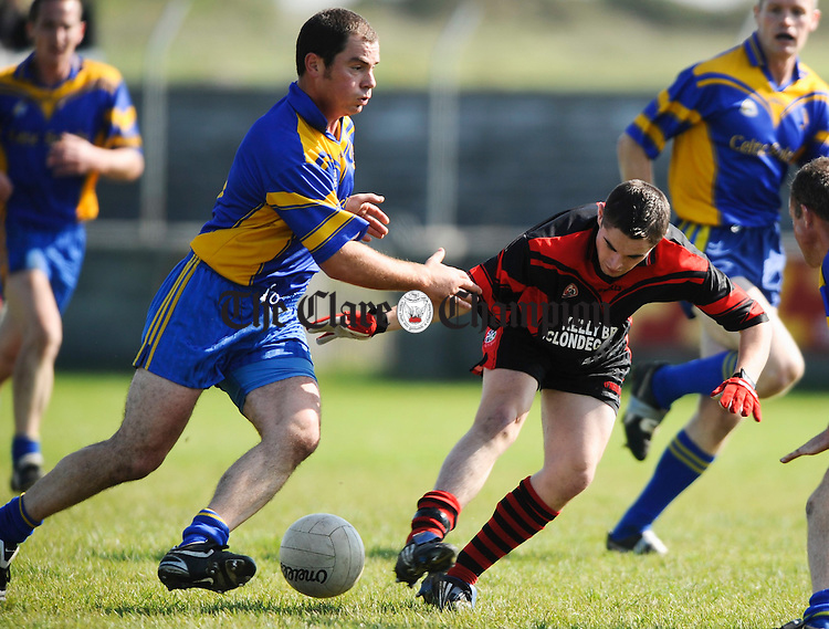Michael Cusacks' Niall Hehir and Clondegad's Francis Neylon contest a ball during their intermediate championship game in Miltown Malbay. Photograph  by John Kelly.