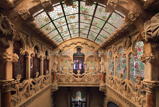 First floor of the living room with decorative stained glass windows and skylight by Jeroni Ferran Granell i Manresa, and marble work by Alfons Juyol, in the Casa Navas, built 1902-7 in Modernist style by Lluis Domenech i Montaner, 1850-1923, Catalan Modernist architect, on the Plaza del Mercadal or Market Square in Reus, Catalonia, Spain. The house was built for Joaquim Navas Padro. The interiors were completed by Alfons Juyol i Bach (marble), Tomas Bergada (paintings), Gaspar Homar (furniture) and Hipolit Montseny (ceramics). The building is listed as a national monument. Picture by Manuel Cohen