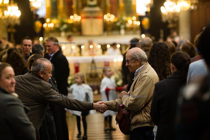 Paris, France, 15.11.2015. men greets during a sunday church service in the Paroisse Saint Elisabeth de Hongrie. Images from Paris in the aftermath of terror attack. Foto: Christopher Olssøn.