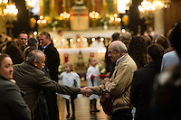 Paris, France, 15.11.2015. men greets during a sunday church service in the Paroisse Saint Elisabeth de Hongrie. Images from Paris in the aftermath of terror attack. Foto: Christopher Olssøn.