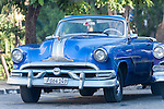Havana, Cuba; a classic blue 1953 Pontiac convertible parked on the street in Old Havana