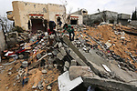 A Palestinian boy walks on the rubble of their destroyed house on a winter cold day, in Khan Youns southern in Gaza city January 20, 2020. Photo by Ashraf Amra