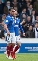 Gary Roberts of Portsmouth congratulates goal scorer Conor Chaplin of Portsmouth during the Sky Bet League 2 match between Portsmouth and Wycombe Wanderers at Fratton Park, Portsmouth, England on 23 April 2016. Photo by Andy Rowland.
