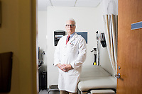 "Dr. Allan Ropper stands in an examination room at Brigham and Women's Hospital in Boston, Massachusetts, on Wed., Sept. 24, 2014. Ropper is the Executive Vice Chair of Neurology at Brigham and a professor at Harvard Medical School specializing in neurology. On September 30, Ropper's recent book ""Reaching Down the Rabbit Hole: A Renowned Neurologist Explains the Mystery and Drama of Brain Disease"" will be published by St. Martin's Press."