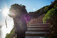 Mount Athos - The Holy Mountain.<br /> A monk starts the journey up the many steps toward his isolated cell.<br /> Photographer: Rick Findler