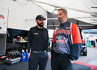 Mar 17, 2019; Gainesville, FL, USA; NHRA top fuel driver Dom Lagana (left) with crew chief Aaron Brooks during the Gatornationals at Gainesville Raceway. Mandatory Credit: Mark J. Rebilas-USA TODAY Sports
