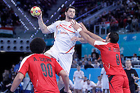 Egypt's Ali Zein (l) and Mohamed Ahmed (r) and Spain's Alberto Entrerrios during 23rd Men's Handball World Championship preliminary round match.January 14,2013. (ALTERPHOTOS/Acero) /NortePhoto
