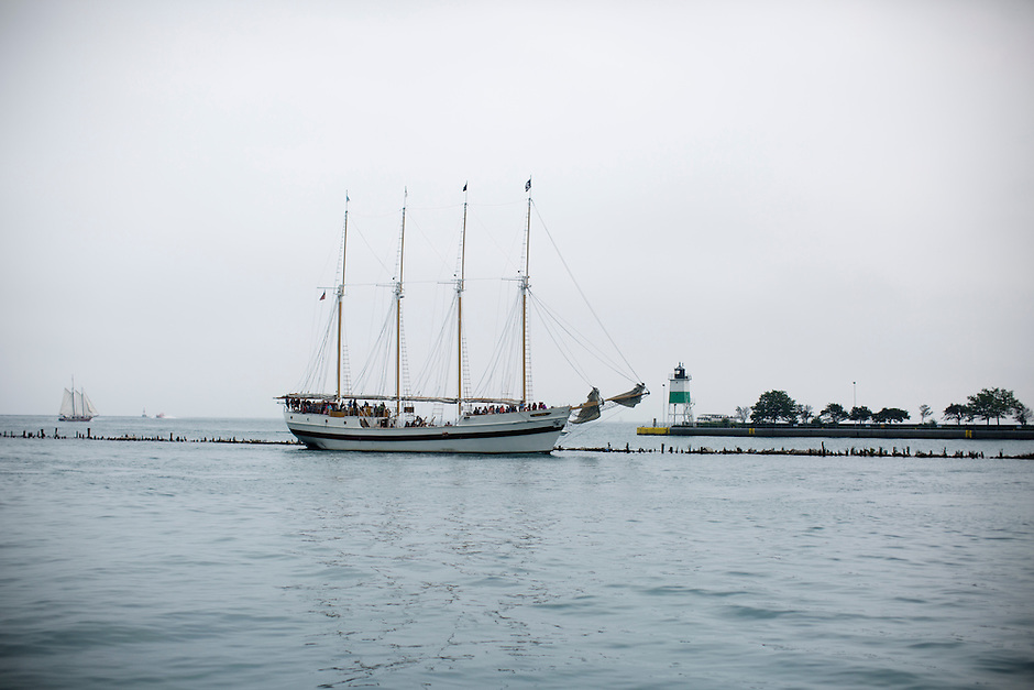 A sail boat returns to port along the Navy Pier on Sunday, Aug. 30, 2015, in Chicago. (Photo by James Brosher)