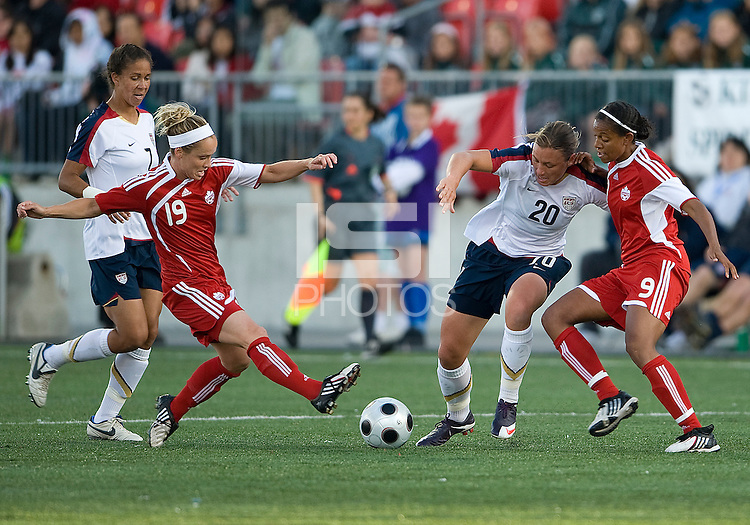 25 May 09:  USA National forward Abby Wambach takes on two Canadian National players #19 in an International Friendly soccer game between the US Women's Team and the Canadian Women's Team at BMO Field in Toronto..The US Women's Team won 4-0..