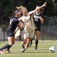 Boston College midfielder Kristen Mewis (19) on her way to the turf. University of Central Florida defender Carleigh Williams (4). After two overtime periods, Boston College tied University of Central Florida, 2-2, at Newton Campus Field, September 9, 2012.