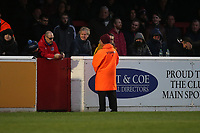 A steward is posted near the halfway line during Dagenham & Redbridge vs Maidenhead United, Vanarama National League Football at the Chigwell Construction Stadium on 7th December 2019