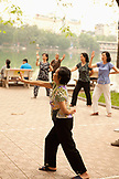 VIETNAM, Hanoi, women practice Tai Chi early in the morning, Hoan Kiem Lake