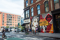 "New York, USA. 23rd Aug, 2017. Passersby stop to admire a newly completed mural, by Shepard Fairey, in the East Villagehe mural features Debbie Harry, lead singer for the rock group Blondie, who got their start in 1979 at CBGB which was located across the street. Fairy's work is also featured in Blondie's latest album ""Polinator"" which was released in May 2017. Credit: Stacy Walsh Rosenstock/Alamy Live News"