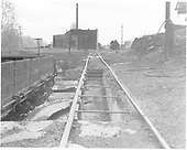 D&amp;RGW Chama ash pit with engine house (2 bays) in background.<br /> D&amp;RGW  Chama, NM  Taken by Morse, Ron - 5/25/1965