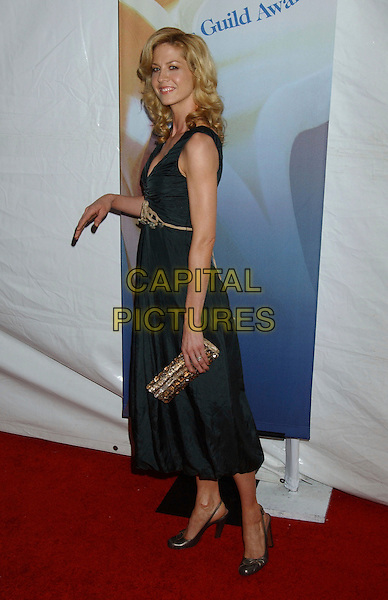 JENNA ELFMAN.2006 Writers Guild Awards held at The Hollywood Palladium, Hollywood, California, USA..February 4th, 2006.Photo: Laura Farr/AdMedia/Capital Pictures.Ref: LF/ADM.full length black green dress gold clutch purse.www.capitalpictures.com.sales@capitalpictures.com.© Capital Pictures.