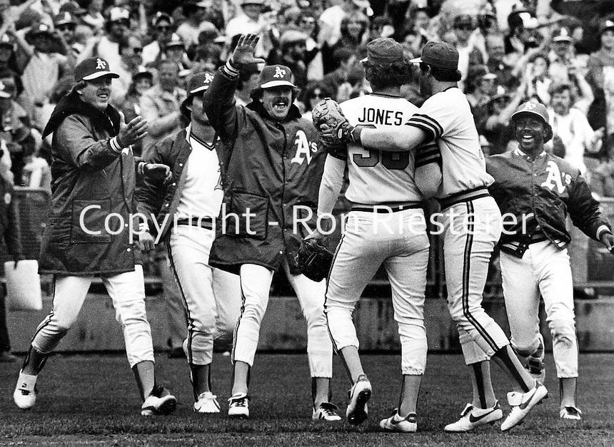 Jeff Jones is greeted by A's teammates after win..(L-R, Steve McCatty, Matt Keough, Wayne Gross and Shooty Babitt.  (1981 photo by Ron Riesterer)