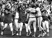 Jeff Jones is greeted by A's teammates after win..(L-R, Steve McCatty, Matt Keough, Wayne Gross and Shooty Babitt.  (1981 photo by Ron Riesterer)
