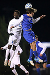 06 November 2012: Duke's Zach Mathers (15) and UNC's Boyd Okwuonu (4) challenge for a header. The University of North Carolina Tar Heels defeated the Duke University Blue Devils 1-0 at Fetzer Field in Chapel Hill, North Carolina in a 2012 NCAA Division I Men's Soccer game. The game was an Atlantic Coast Conference quarterfinal match.