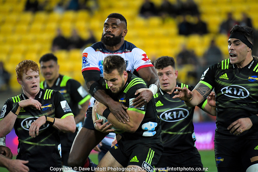 Wes Goosen takes a high ball under pressure from Marika Koroibete during the Super Rugby match between the Hurricanes and Rebels at Westpac Stadium in Wellington, New Zealand on Saturday, 4 May 2019. Photo: Dave Lintott / lintottphoto.co.nz