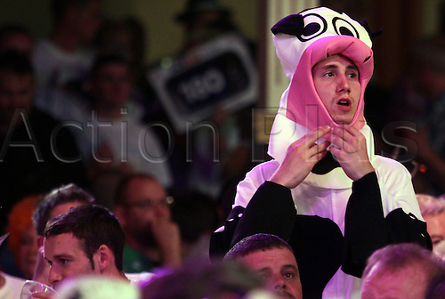 23.07.2011 World Match Play Darts from the Winter Gardens in Blackpool. A fan in fancy dress watches on as James Wade dominates the match.