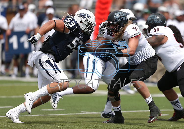 Nevada's Brock Hekking (53) plays against Southern Utah's Trevor McFalls (51) in an NCAA college football game on Saturday, Aug. 30, 2014, in Reno, Nev. Southern Utah's P.J. Taeao (59) is at right. (AP Photo/Cathleen Allison)