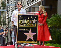 LOS ANGELES, CA. September 20, 2018: Carrie Underwood & Simon Cowell at the Hollywood Walk of Fame Star Ceremony honoring singer Carrie Underwood.<br /> Pictures: Paul Smith/Featureflash