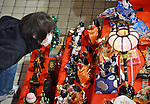 """February 17, 2013, Konosu, Japan - A girl takes a closer look at Girls' Fewstival ornamental dolls displayed on the red-carpeted platform in a huge pyramid shape at the lobby of Konosu city hall, north of Tokyo, on Sunday, February 17, 2013. The dolls numbered 18,000 represent emperor, empress, attendants and musicians in the ancient Imperial court. The city of Konosu, situated some 40 km north of Tokyo, is known as """" the doll town"""" for a number of factories manufacturing Japanese dolls. Japanese tradition calls upon families with daughters for putting out dolls for the Girls Day on March 3 with the hopes that they grow up healthy and happily. (Photo by Natsuki Sakai/AFLO) AYF -mis-."""