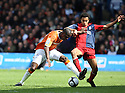 Claude Gnakpa of Luton and James Meredith of York City challenge for the ball during the Blue Square Premier play-off semi-final 2nd leg  match between Luton Town and York City at Kenilworth Road, Luton on Monday 3rd May, 2010..© Kevin Coleman 2010 ..