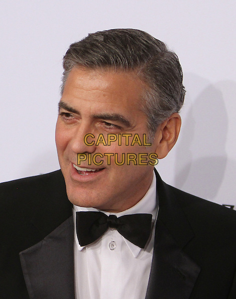 George Clooney.26th Annual Carousel of Hope Gala held at the Beverly Hilton Hotel, Beverly Hills, California, USA, 20th October 2012..headshot portrait black tuxedo tux bow tie smiling .CAP/ADM/KB.©Kevan Brooks/AdMedia/Capital Pictures.