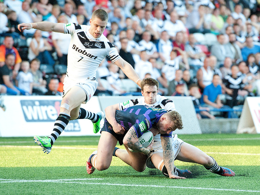Wigan Warriors' Josh Charnley is caught and tackled by Widnes Vikings' Joe Mellor <br /> <br />  (Photo by Stephen White/CameraSport) <br /> <br /> Rugby League - Super League - Widnes Vikings v Wigan Warriors - Friday  7th June 2013 - Stobart Stadium - Halton<br /> <br /> &copy; CameraSport - 43 Linden Ave. Countesthorpe. Leicester. England. LE8 5PG - Tel: +44 (0) 116 277 4147 - admin@camerasport.com - www.camerasport.com