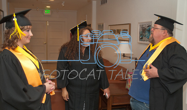 Brittany Esposito, left, Rebecca Benner and Steve Vaughn talk about future plans at the Western Nevada College commencement in Fallon, Nev., on Tuesday, May 20, 2014. <br /> Photo by Kim Lamb