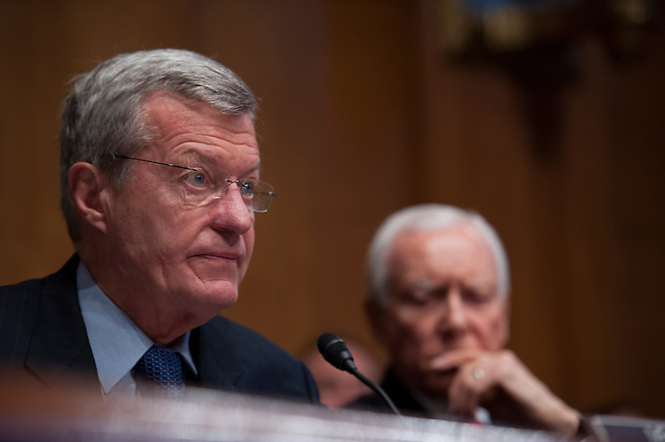 UNITED STATES - May 21: Chairman Max Baucus, D-MT., and Sen. Orrin Hatch, R-UT., during the Senate Finance Committee hearing on 'Internal Revenue Service Targeting Conservative Groups' on Capitol Hill in Washington,DC on May 20, 2013.  (Photo By Douglas Graham/CQ Roll Call)