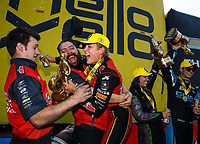 Aug 20, 2017; Brainerd, MN, USA; NHRA top fuel driver Leah Pritchett celebrates with crew members after winning the Lucas Oil Nationals at Brainerd International Raceway. Mandatory Credit: Mark J. Rebilas-USA TODAY Sports