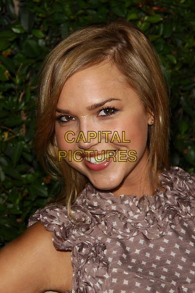 """ARIELLE KEBBEL .""""Capitalism: A Love Story"""" Los Angeles Premiere held at  The Samuel Goldwyn Theatre, Beverly Hills, California, USA, .15th September 2009..portrait headshot brown polka dot smiling .CAP/ADM/TC.©T. Conrad/Admedia/Capital Pictures"""