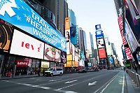 """New York, New York City. New Yorkers are told to stay home during the corona virus, (COVID-19) so New York has become eerily empty.  Times Square is devoid of its usual crowds. """"Thank you to our healthcare workers"""" sign."""