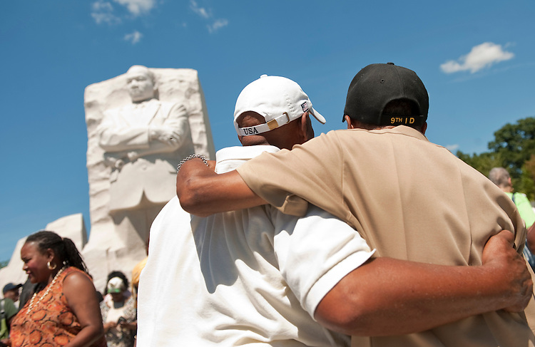 UNITED STATES - AUGUST 23:  George Walker III, right, and William Wilson, view the Martin Luther King Jr. Memorial.  The memorial, located on the Tidal Basin, is open to viewing by the public and the official dedication ceremony will take place on August 28.  (Photo By Tom Williams/Roll Call)